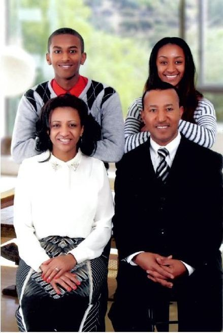 Pastor Ambelie with his family